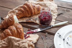 Fresh croissant with berry jam Royalty Free Stock Photos