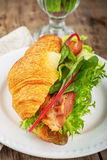 Fresh croissant for breakfast stuffed with bacon Stock Photo