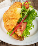 Fresh croissant for breakfast stuffed with bacon Royalty Free Stock Image