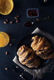 Fresh croissant with chocolate glaze on breakfast Stock Images
