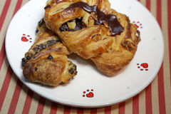 Fresh croissant with chocolate on white plate. Fresh croissant with chocolate on white plate Stock Photos