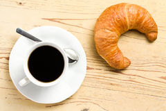 Fresh croissant with coffee Stock Image