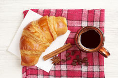 Fresh croissant and coffee cup Royalty Free Stock Images