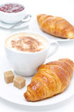 Fresh croissant, coffee and jam for breakfast Royalty Free Stock Photography