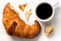 Fresh croissant and a cup of black coffee Stock Image