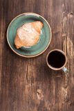 Fresh croissant and cup of black coffee Royalty Free Stock Photos