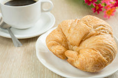 Fresh croissant with cup of black coffee Royalty Free Stock Photography
