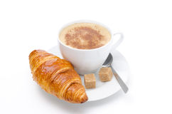 Fresh croissant and cup of cappuccino with brown sugar isolated Royalty Free Stock Image