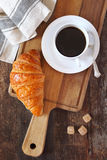 Fresh croissant and cup of coffee for breakfast Stock Image