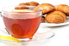Fresh croissant and cup of tea Royalty Free Stock Photography