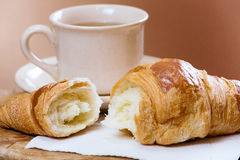 Fresh croissant and cup of tea Stock Image