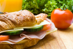 Fresh croissant with ham, cheese and salad Royalty Free Stock Photo