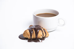 Fresh croissant with hot chocolate and coffee. Fresh croissant with hot chocolate on a white background with a coffee Royalty Free Stock Photo