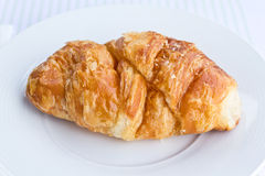 The fresh croissant isolated. On white plate Stock Photos