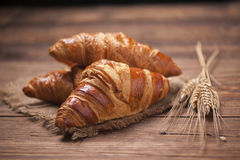 Fresh Croissant, italian breakfast. Close up. Stock Photo