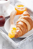 Fresh croissant with jam for breakfast Royalty Free Stock Photography