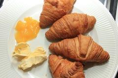 Fresh croissant and lemon curd stock photography