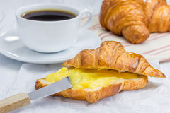 Fresh croissant with lemon curd and coffee. Fresh croissant with lemon curd and cup of coffee Royalty Free Stock Image