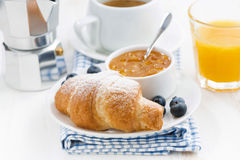 Fresh croissant with orange jam and blueberries Stock Photo