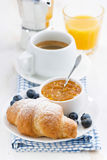 Fresh croissant with orange jam, blueberries and coffee Stock Photography