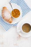 fresh croissant with orange jam and coffee, top view, vertical Stock Photography