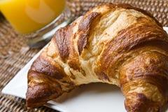Fresh croissant with orange juice Stock Images