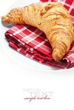 Fresh croissant on plate Stock Images