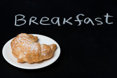 Fresh croissant on a plate on the blackboard Stock Image
