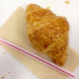 fresh croissant and straw on tissue paper Stock Image