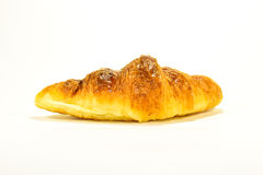 Fresh Croissant on white background. Single fresh croissant, casting soft whadow on white. Delicious Stock Photography
