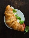 Fresh Croissant wtih Caprese Filling. Caprese Croissant With Mozzarella, Tomato and Basil Royalty Free Stock Image