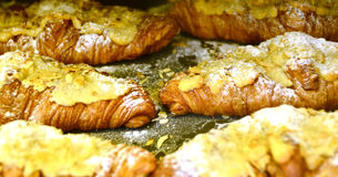 Fresh  croissants with almond  in  bakery. There are some fresh and hot  croissants with almond on the tray in bakery  or cafe Royalty Free Stock Photos