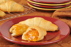 Fresh croissants with apricot jam Stock Photography