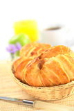 Fresh Croissants in Basket Stock Photo