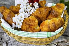 Fresh croissants in a basket from bakery. Fresh french croissants in a basket from bakery on wooden background Stock Photo