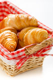 Fresh croissants in a basket Royalty Free Stock Photos
