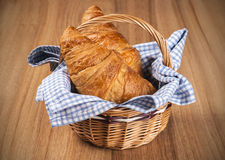 Fresh Croissants in a basket Stock Images
