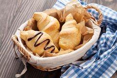 Fresh croissants basket Stock Photography