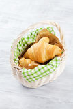 Fresh croissants basket Royalty Free Stock Images