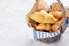Fresh croissants basket Stock Photos