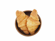 Fresh croissants bread in wood bowl isolated on white background Royalty Free Stock Photos