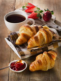 Fresh croissants with coffee cup for a breakfast Stock Photos