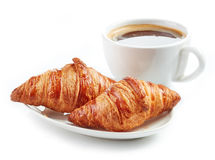 Fresh croissants and coffee cup Stock Photos