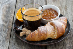 Fresh croissants, coffee and jam Royalty Free Stock Images