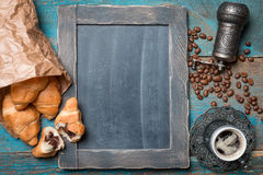 Fresh croissants and coffee. On wooden table. Top view with copy space stock photography