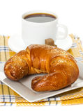 Fresh croissants and cup of coffee Stock Photography