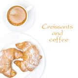 Fresh croissants and cup of coffee isolated, top view Royalty Free Stock Images