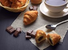 Fresh croissants and a cup of hot tea / coffee. Breakfast. Homemade croissants with chocolate. Tasty hot croissants for breakfast. Homemade croissants. Baking royalty free stock image