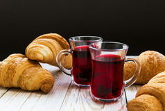 Fresh Croissants and cups of hot hibiscus tea Stock Photo