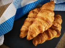 Fresh croissants on a dark background Stock Image
